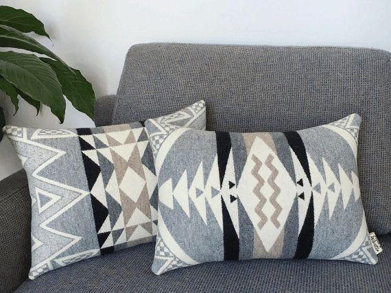 """""""Look for cozy fabrics, like wool, with geometric prints to create an instant stay-at-home feel,"""" Johnson says. <a href=""""https://www.etsy.com/listing/449572010/geometric-wool-pillow-stone-triangle"""" target=""""_blank"""">Shop them here</a>."""