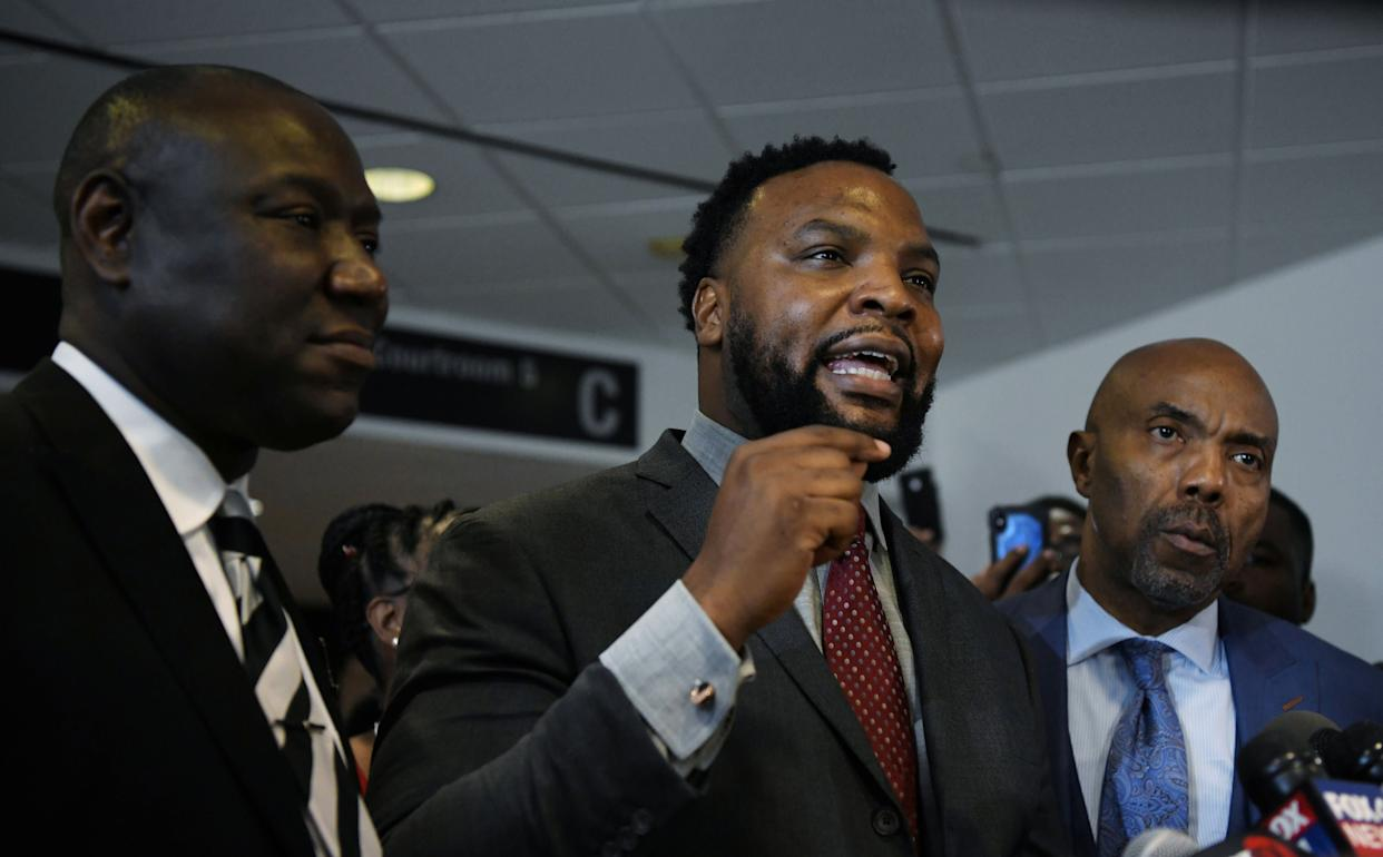 Botham Jean's family attorneys, Benjamin Crump, Lee Merrit and Daryl Washington, address the press after the conviction charge of murder was delivered on Oct. 1. (Photo: Jeremy Lock / Reuters)