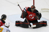 New Jersey Devils goaltender Scott Wedgewood (41) makes a stick save during the first period of the team's NHL hockey game against the Pittsburgh Penguins, Thursday, March 18, 2021, in Newark, N.J. (AP Photo/John Minchillo)