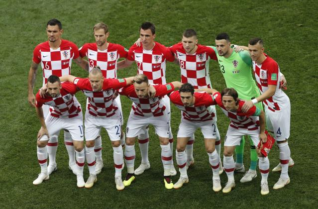 Croatia starting players pose for a team photo at the beginning of the final match between France and Croatia at the 2018 soccer World Cup in the Luzhniki Stadium in Moscow, Russia, Sunday, July 15, 2018. (AP Photo/Frank Augstein)