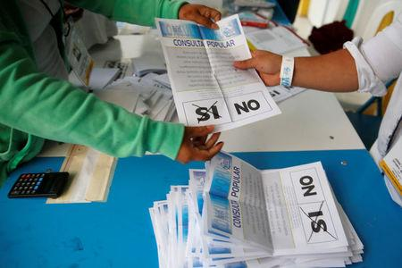 Poll workers count ballots after polls closed at a polling station during a referendum on a border dispute with Belize in  Guatemala City, Guatemala April 15, 2018. REUTERS/Luis Echeverria