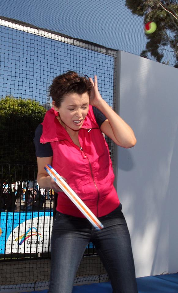 Dannii Minogue was at the launch of a new outdoor kids' tennis court in Melbourne when she decided to have a game herself. She didn't anticipate being hit on the head by one of the balls, though. Ouch!