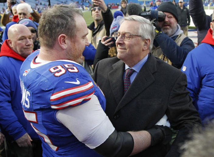 Miami Dolphins owner Stephen M. Ross talks with defensive tackle Kyle Williams speak after an NFL football game against the Miami Dolphins, Sunday, Dec. 30, 2018, in Orchard Park, N.Y. The Bills won 42-17. (AP Photo/Jeffrey T. Barnes)