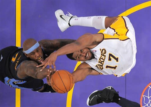 Denver Nuggets power forward Al Harrington, left, and Los Angeles Lakers center Andrew Bynum battle for a rebound during the first half of an NBA first-round playoff basketball game, Sunday, April 29, 2012, in Los Angeles. (AP Photo/Mark J. Terrill)