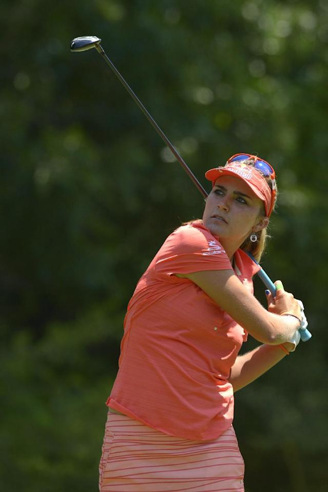 Lexi Thompson watches her tee shot on the fifth hole in the second round of the Airbus LPGA Classic golf tournament at Magnolia Grove on Friday, May 23, 2014, in Mobile, Ala. (AP Photo/G.M. Andrews)