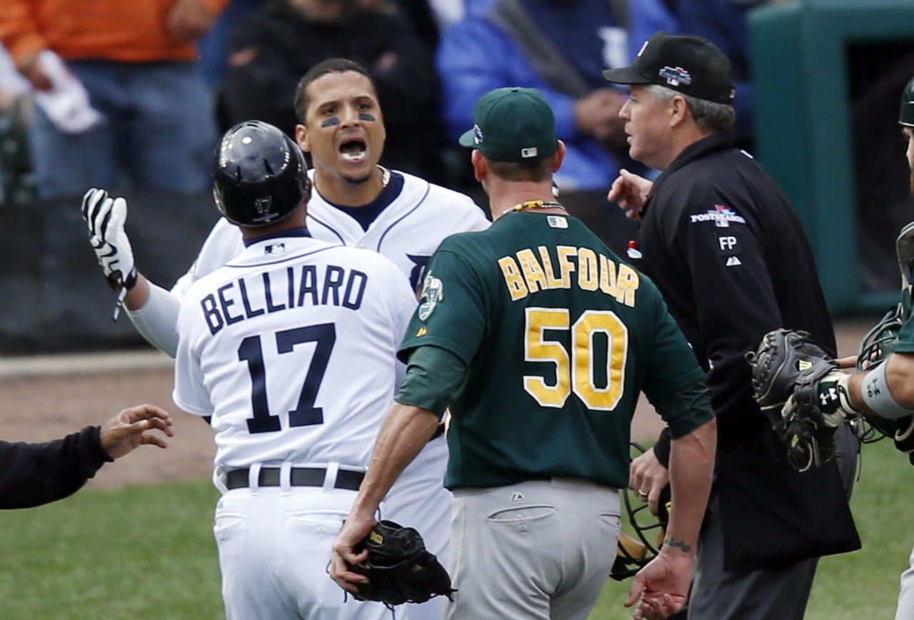 Detroit Tigers first base coach Rafael Belliard (17) and home plate umpire Gary Darling, right, step between Detroit Tigers designated hitter Victor Martinez, second from left, and Oakland Athletics relief pitcher Grant Balfour during the ninth inning of Game 3 of an American League baseball division series in Detroit, Monday, Oct. 7, 2013. (AP Photo/Charles Rex Arbogast)