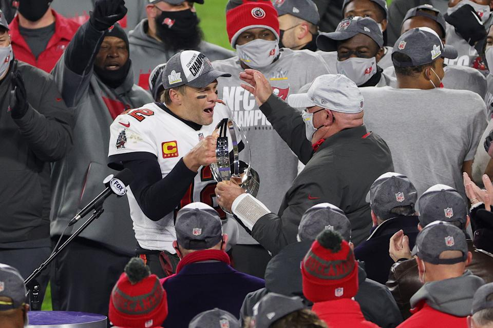 GREEN BAY, WISCONSIN - JANUARY 24: Tom Brady #12 of the Tampa Bay Buccaneers celebrates with head coach Bruce Arians and teammates after their 31 to 26 win over the Green Bay Packers during the NFC Championship game at Lambeau Field on January 24, 2021 in Green Bay, Wisconsin. (Photo by Stacy Revere/Getty Images)