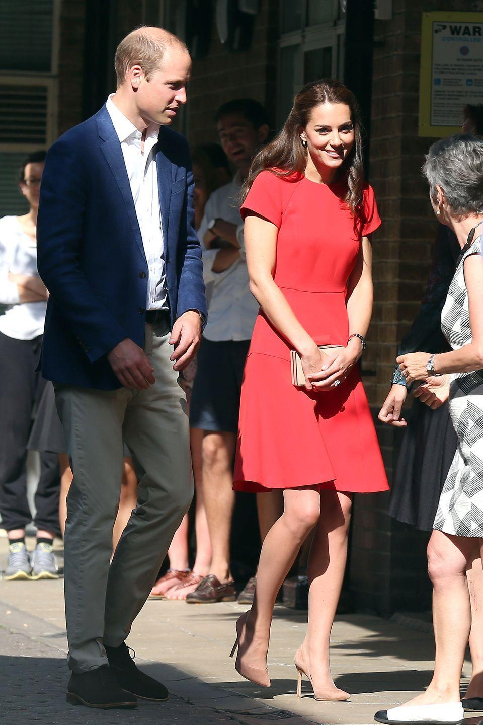 <p>Middleton wears a red dress and beige clutch by L.K.Bennett, paired with pointed-toe nude pumps while out with Prince William in London.</p>
