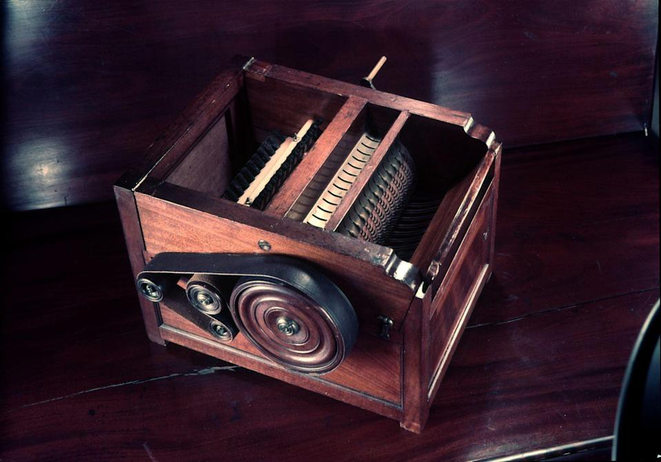 """<p>The 1793 invention of the cotton gin by Eli Whitney showed ingenuity in early American establishments, even if there were unintended consequences for the progress. The hand-cranked gin separated seeds at a <a href=""""https://todayincthistory.com/2019/03/14/march-14-eli-whitney-patents-the-cotton-gin/"""" rel=""""nofollow noopener"""" target=""""_blank"""" data-ylk=""""slk:rate of 50 pounds of cotton per day"""" class=""""link rapid-noclick-resp"""">rate of 50 pounds of cotton per day</a>, an improvement over 50 times of doing the work by hand. This sped up the amount of cotton sent to textile mills, but also pushed plantations larger, increasing the slave trade.</p>"""