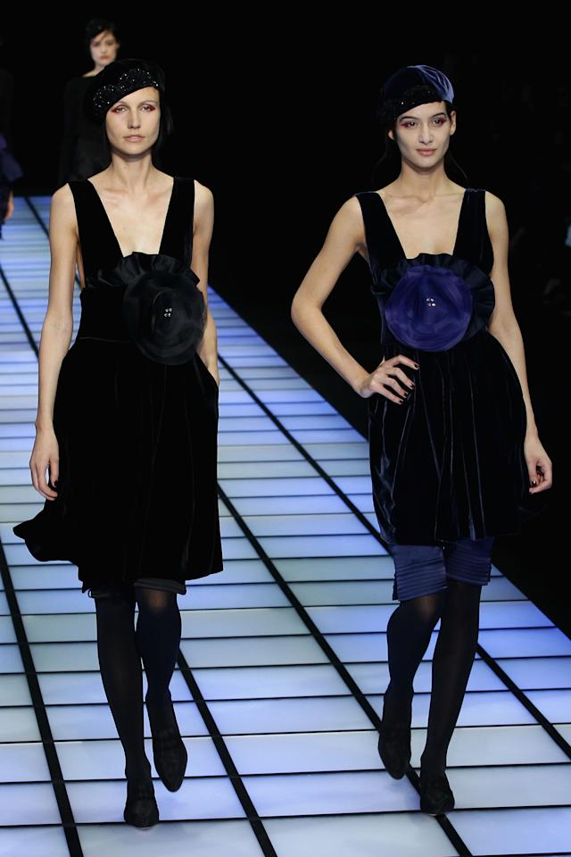 MILAN, ITALY - FEBRUARY 25:  Models walk the runway at the Emporio Armani Autumn/Winter 2012/2013 fashion show as part of Milan Womenswear Fashion Week on February 25, 2012 in Milan, Italy.  (Photo by Vittorio Zunino Celotto/Getty Images)