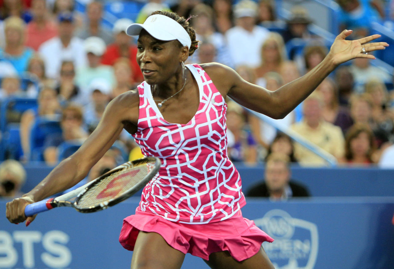 Venus Williams volleys against Li Na, from China, during a semifinals match at the Western & Southern Open tennis tournament, Saturday, Aug. 18, 2012, in Mason, Ohio. (AP Photo/Al Behrman)