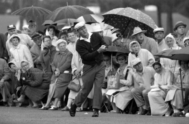 <p>Golf great Arnold Palmer follows through after a tee shot at Augusta National Golf Club in Augusta, Georgia during the 1961 Masters Tournament. (Photo by Rogers Photo Archive/Getty Images) </p>