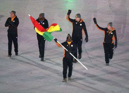 Feb 9, 2018; Pyeongchang, South Korea; Akwasi Frimpong, the flag bearer for Ghana, walks with his fellow athletes during the opening ceremony of the Pyeongchang 2018 Olympic Winter Games at Pyeongchang Olympic Stadium. Mandatory Credit: Matt Kryger-USA TODAY Sports