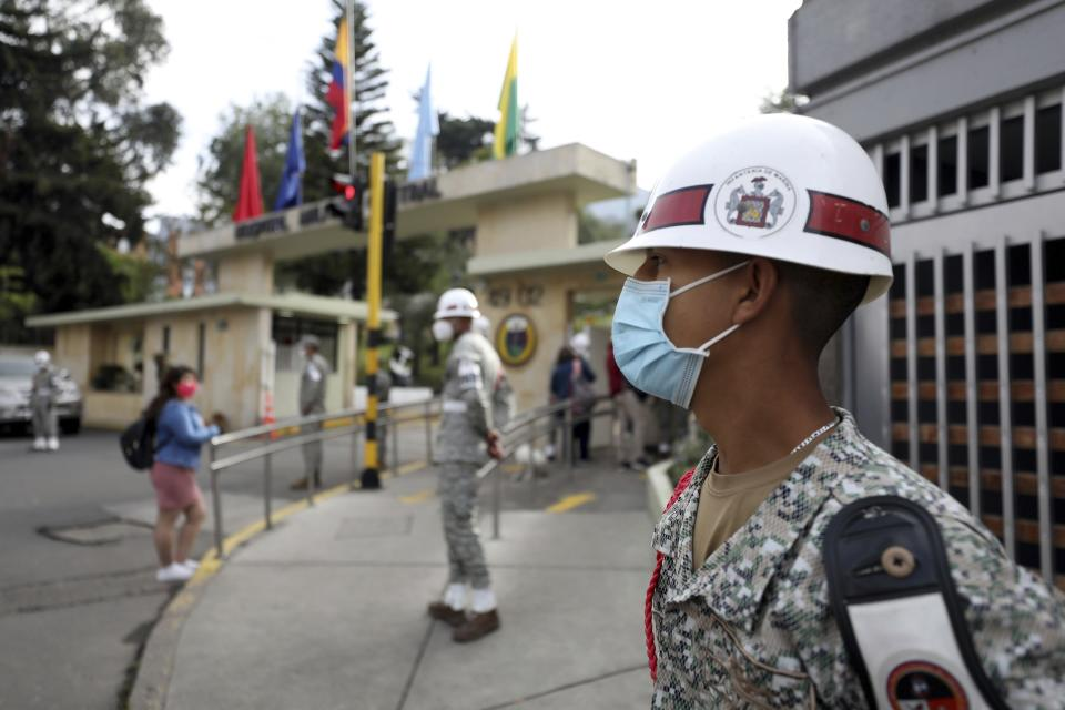 Soldiers stand guard outside the military hospital where Defense Minister Carlos Holmes Trujillo died of complications of COVID-19 in Bogota, Colombia, Tuesday, Jan. 26, 2021. President Ivan Duque said that Trujillo died early Tuesday. (AP Photo/Fernando Vergara)