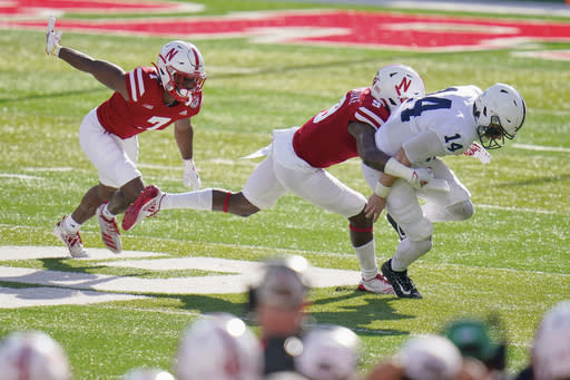 Nebraska cornerback Dicaprio Bootle (7) and safety Marquel Dismuke (9) apply pressure on Penn State quarterback Sean Clifford (14) during the first half of an NCAA college football game in Lincoln, Neb., Saturday, Nov. 14, 2020. (AP Photo/Nati Harnik)