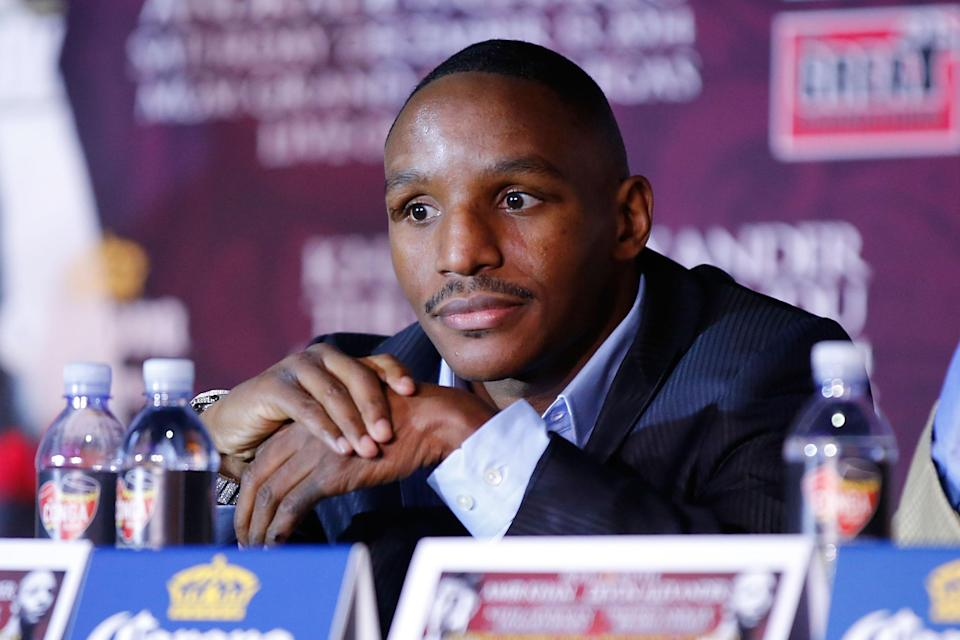 Devon Alexander sits onstage during the Amir Khan & Devon Alexander Fight Announcement at The Conga Room on November 4, 2014 in Los Angeles, California (AFP Photo/Joe Scarnici)