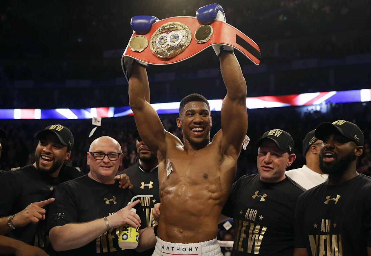 FILE - In this Saturday, April 9, 2016 file photo, British boxer Anthony Joshua celebrates after winning the IBF heavyweight title bout against US boxer Charles Martin at the O2 Arena in London. Undefeated American heavyweight Dominic Breazeale will challenge Anthony Joshua for his IBF title at London's O2 Arena on June 25. The 30-year-old former U.S. Olympic heavyweight was selected Monday April 25, 2016 as Joshua's opponent for his first title defense. (AP Photo/Matt Dunham, File)