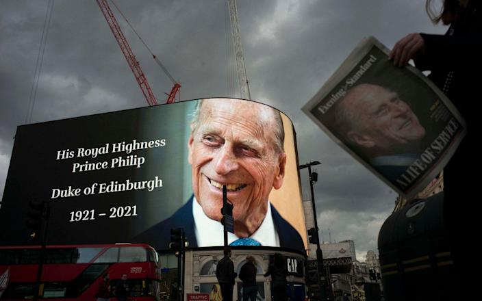 A tribute to Prince Phillip shines in Piccadilly Circus, and the general public is reading a treatise from the page with him-Rick Findler & # xa0;