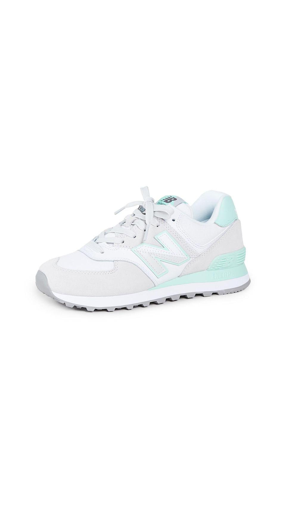 """<p><strong>New Balance</strong></p><p>shopbop.com</p><p><a href=""""https://go.redirectingat.com?id=74968X1596630&url=https%3A%2F%2Fwww.shopbop.com%2F574-split-sail-sneaker-new%2Fvp%2Fv%3D1%2F1568048225.htm&sref=https%3A%2F%2Fwww.harpersbazaar.com%2Ffashion%2Ftrends%2Fg34632594%2Fshopbop-holiday-sale%2F"""" rel=""""nofollow noopener"""" target=""""_blank"""" data-ylk=""""slk:Shop Now"""" class=""""link rapid-noclick-resp"""">Shop Now</a></p><p><strong><del>$80</del> $56 (34% off)</strong></p><p>New Balance's resurgence in the fashion world has felt especially vast this year. Here, the brand's legendary 574 sneakers, which Rihanna has worn in various color combos. </p>"""