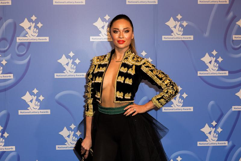 Dancer Katya Jones poses for photographers upon arrival at the National Lottery Awards, in central London, Friday, Sept. 9, 2016. (Photo by Grant Pollard/Invision/AP)