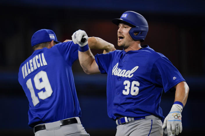 Israel's Ryan Lavarnway, right, celebrate with Danny Valencia after hitting a home run in the ninth inning a baseball game against South Korea at the 2020 Summer Olympics, Thursday, July 29, 2021, in Yokohama, Japan. (AP Photo/Sue Ogrocki)