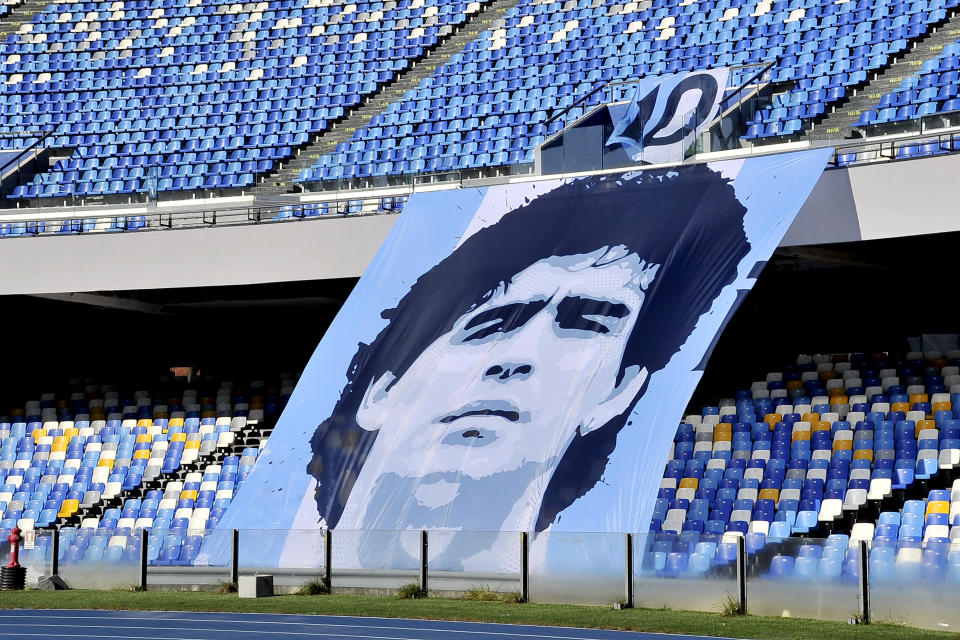 NAPOLI, ITALY - 2020/12/13: Giant photo of Diego Armando Maradona put by the fans in the stands to remember his disappearance, during the match of the Italian football championship between Napoli vs Sampdoria final result 2-1, match played at the Diego Armando Maradona stadium in Naples. (Photo by Vincenzo Izzo/LightRocket via Getty Images)