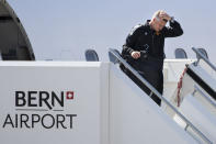 Manchester United's head coach Ole Gunnar Solskjaer disembarks from a plane as he arrives at the Bern Airport, Switzerland Monday, Sept. 13, 2021 one day ahead of the Champions League soccer match between Young Boys Bern and Manchester United. (Peter Klaunzer/Keystone via AP)