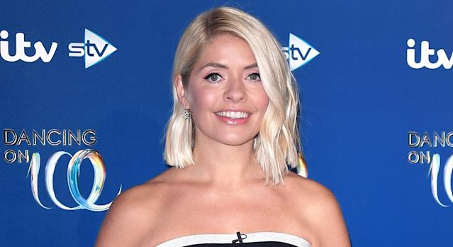 Holly Willoughby puts on a glamorous display in a Warehouse floral dress on This Morning. (Getty images)
