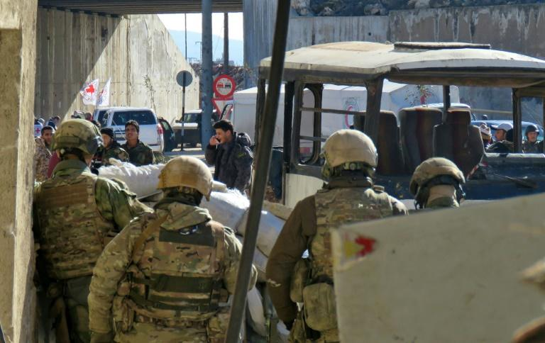 Russian soldiers gather in the government-held side of Aleppo before the start of an evacuation operation of rebel-held areas on December 15, 2016