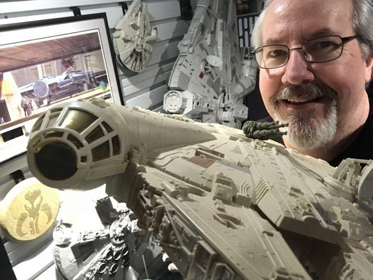 Designer Mark Boudreaux in his office with the <i>Millennium Falcon</i> vehicles he has designed over the past 40 years. (Credit: Hasbro)
