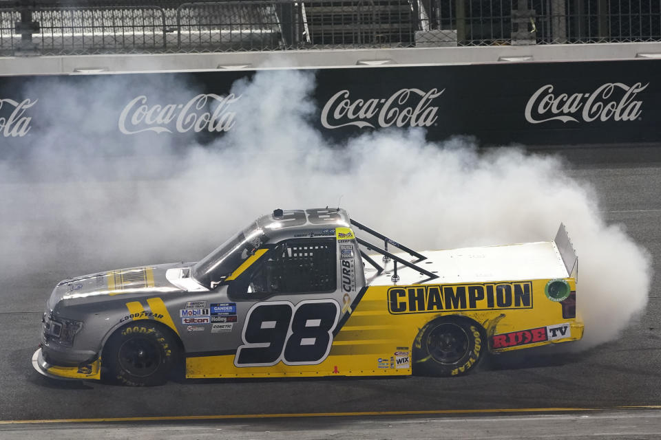 FILE - Grant Enfinger does a burnout as he celebrates his victory in a NASCAR Truck Series auto race in Richmond, Va., in this Thursday, Sept. 10, 2020, file photo. The underappreciated Truck Series opens NASCAR's championship weekend with an under the lights Friday night Nov. 6 shootout that could be the most entertaining event at Phoenix Raceway. The path to the winner-take-all finale has been a flat-out demolition derby with two consecutive weeks of wild driving. (AP Photo/Steve Helber, File)