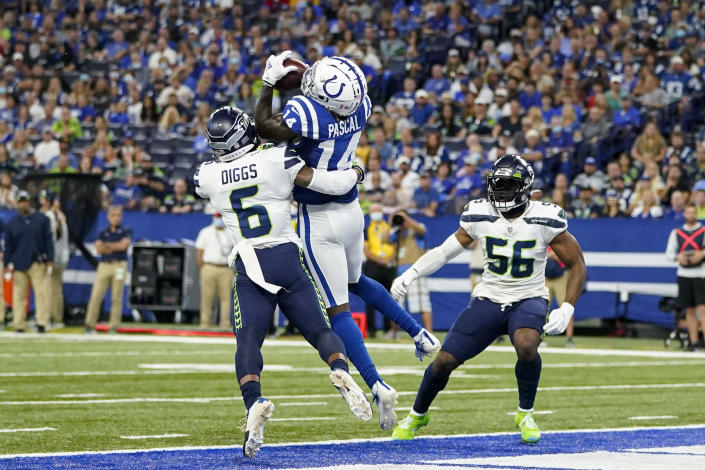 Indianapolis Colts wide receiver Zach Pascal (14) makes catch between Seattle Seahawks strong safety Quandre Diggs (6) and linebacker Jordyn Brooks (56) for a touchdown in the first half of an NFL football game in Indianapolis, Sunday, Sept. 12, 2021. (AP Photo/Charlie Neibergall)