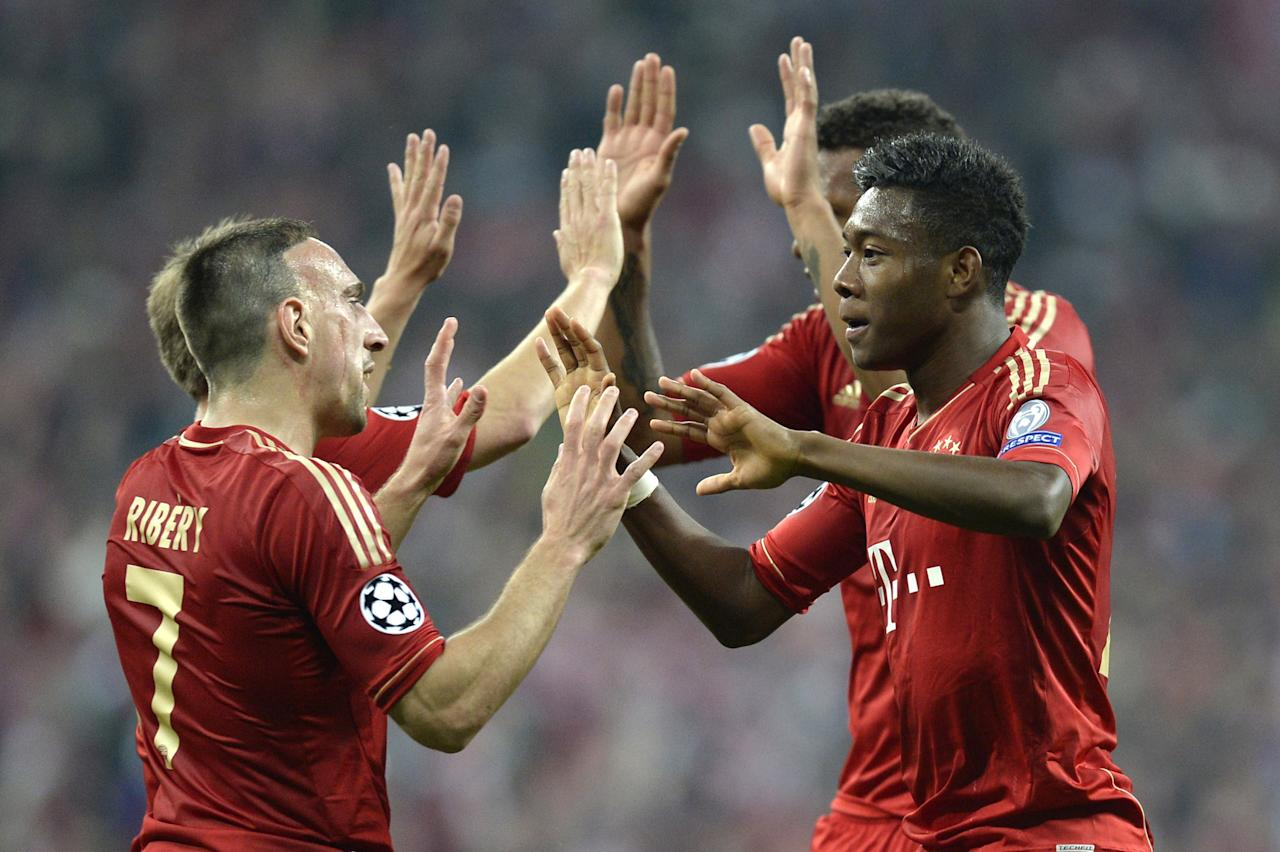 Bayern Munich's French midfielder Franck Ribery (L) and Bayern Munich's Austrian midfielder David Alaba (R) celebrate a goal during the UEFA champions league semi final first leg football match FC Bayern Muenchen vs FC Barcelona on April 23, 2013 in Munich, southern Germany.  AFP PHOTO CHRISTOF STACHECHRISTOF STACHE/AFP/Getty Images