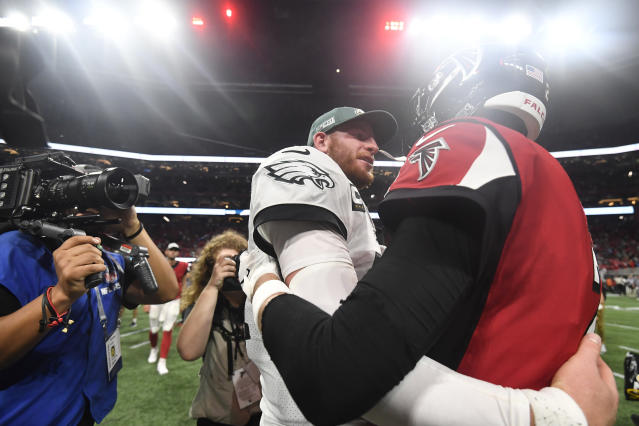 Philadelphia Eagles quarterback Carson Wentz (11) speaks with Atlanta Falcons quarterback Matt Ryan (2) after an NFL football game, Sunday, Sept. 15, 2019, in Atlanta. The Atlanta Falcons won 24-20. (AP Photo/John Amis)