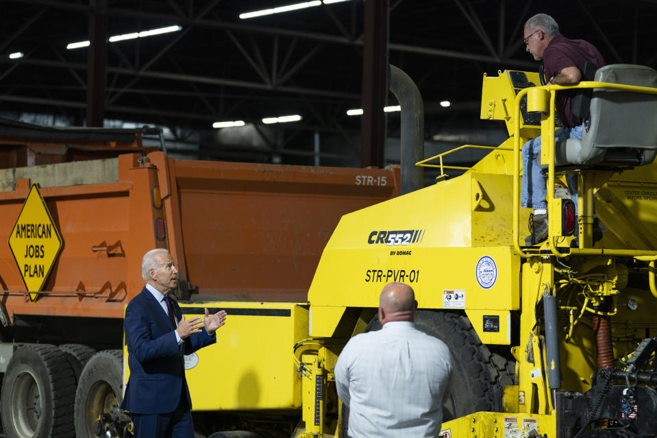 President Joe Biden participates in a tour of the La Crosse Municipal Transit Authority with Adam Lorentz, Transit Manager, La Crosse Municipal Transit Utility, right, and Mike La Fleur, the superintendent of streets for the MTU, center, Tuesday, June 29, 2021, in La Crosse, Wis. (AP Photo/Evan Vucci)
