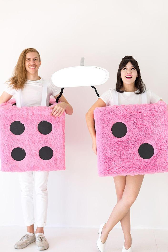 """<p>Roll the dice on winning best costume in this hilarious outfit, which is surprisingly simple to make using fuzzy pink blankets. Add as many friends as you can to really rock (and roll) Halloween.</p><p><strong>Get the tutorial at <a href=""""http://www.awwsam.com/2017/10/diy-fuzzy-dice-group-costume.html"""" rel=""""nofollow noopener"""" target=""""_blank"""" data-ylk=""""slk:Aww Sam"""" class=""""link rapid-noclick-resp"""">Aww Sam</a>.</strong></p><p><a class=""""link rapid-noclick-resp"""" href=""""https://www.amazon.com/gp/product/B071HGQK1F/ref=oh_aui_detailpage_o01_s00?tag=syn-yahoo-20&ascsubtag=%5Bartid%7C10050.g.32906192%5Bsrc%7Cyahoo-us"""" rel=""""nofollow noopener"""" target=""""_blank"""" data-ylk=""""slk:SHOP PINK FUR BLANKETS"""">SHOP PINK FUR BLANKETS </a></p>"""