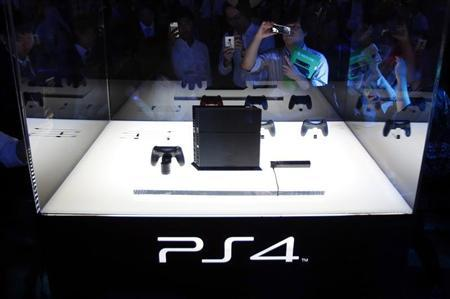 Visitors take pictures of Sony Corp's PlayStation 4 new game console at the Tokyo Game Show in Chiba