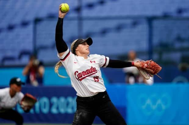 Canada's Danielle Lawrie pitches during a spectator-less softball game against Italy at Yokohama Stadium during the Olympics on Monday in Yokohama, Japan.  (Matt Slocum/The Associated Press - image credit)