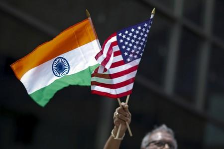 FILE PHOTO: Man holds flags of India and the U.S. during the 35th India Day Parade in New York