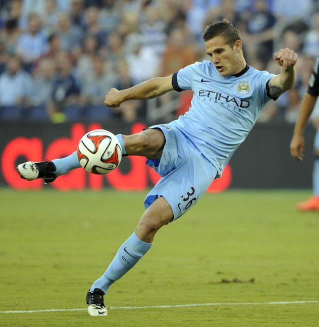 Manchester City FC midfielder Bruno Zuculini scores against Sporting Kansas City during an exhibition match at Sporting Park on July 23, 2014 in Kansas City, Kansas (AFP Photo/Dave Kaup)