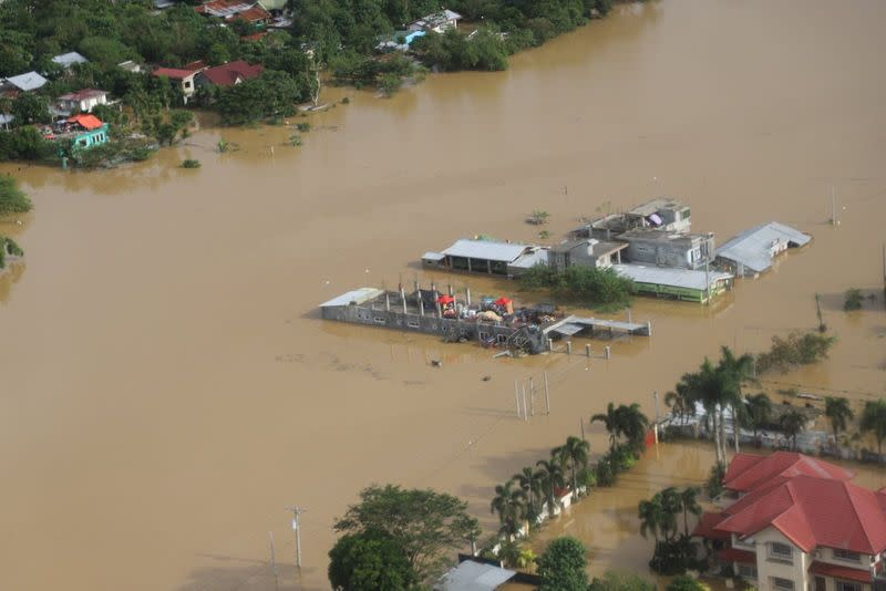 Buildings are flooded in the aftermath of Typhoon Vamco, in the Cagayan Valley region