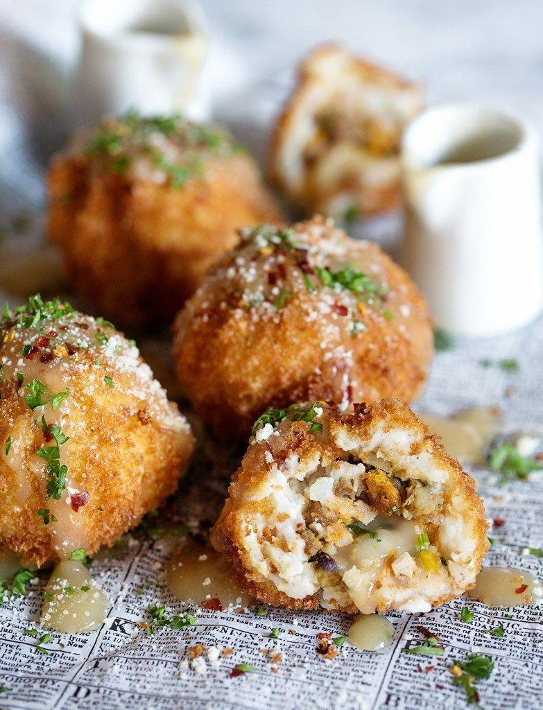 """<p>The only way to enjoy leftover stuffing, turkey, and mashed potatoes? Deep fry 'em and dip 'em in leftover gravy. Yum! </p><p><strong>Get the recipe at <u><a href=""""https://realfoodbydad.com/thanksgiving-leftover-balls/"""" rel=""""nofollow noopener"""" target=""""_blank"""" data-ylk=""""slk:Real Food by Dad"""" class=""""link rapid-noclick-resp"""">Real Food by Dad</a></u>.</strong></p><p><strong><a class=""""link rapid-noclick-resp"""" href=""""https://go.redirectingat.com?id=74968X1596630&url=https%3A%2F%2Fwww.walmart.com%2Fip%2FWilton-Bake-It-Better-Non-Stick-Baking-Pan-Set-3-Piece%2F44432741&sref=https%3A%2F%2Fwww.countryliving.com%2Ffood-drinks%2Fg1064%2Fthanksgiving-leftovers%2F"""" rel=""""nofollow noopener"""" target=""""_blank"""" data-ylk=""""slk:SHOP BAKING SHEETS"""">SHOP BAKING SHEETS</a></strong></p>"""