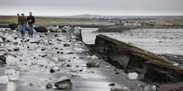 PHOTO: People walk where glacial outburst flooding from Myrdalsjokull, Iceland, swept away a bridge over the Mulakvisi river, July 9, 2011. (Arctic-images/Getty Images, FILE)