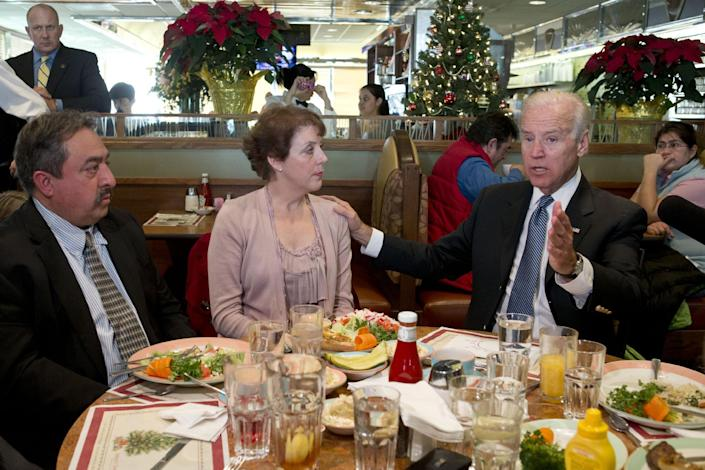 Vice President Joe Biden, right, speaks to the media after eating lunch with middle class tax-payers including Fernando Garavito, of North Potomac, Md., left, Anne Marie Munos, of Falls Church, Va., Friday, Dec. 7, 2012, at the Metro 29 diner in Arlington, Va. (AP Photo/Jacquelyn Martin)