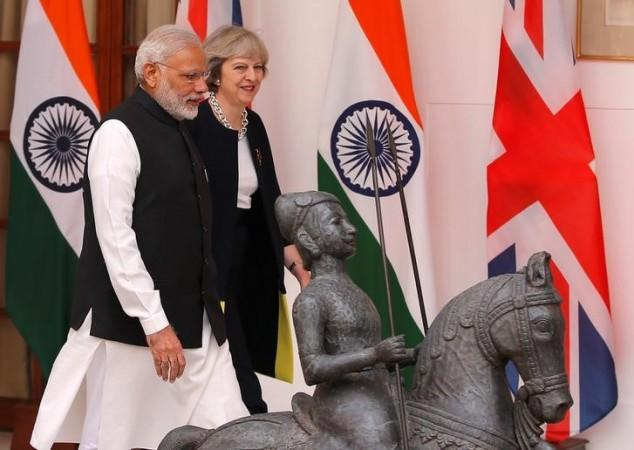 Theresa May and Narendra Modi