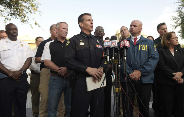 <p>Orlando Police Chief John Mina, center, addresses reporters during a news conference after a shooting involving multiple fatalities at a nightclub in Orlando, Fla., Sunday, June 12, 2016. (AP Photo/Phelan M. Ebenhack) </p>
