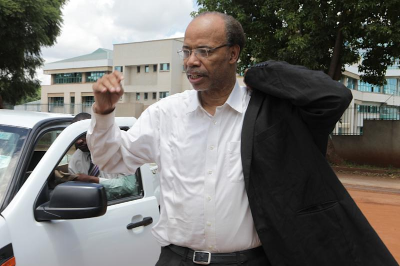 Former U S Congressman, Mel Reynolds, arrives to appear at the magistrates courts in Harare, Wednesday, February, 19, 2014. Reynolds was arrested in Zimbabwe for allegedly possessing pornographic material and violating immigration laws. (AP Photo/Tsvangirayi Mukwazhi)