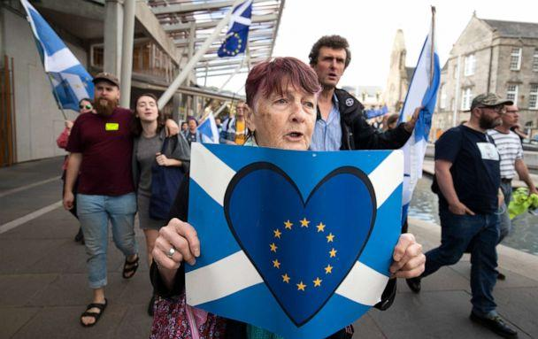 PHOTO: Protesters from the European Movement in Scotland hold a walking vigil outside the Scottish Parliament in Edinburgh to demonstrate against Prime Minister Boris Johnson proroguing Parliament, in Scotland, Aug. 28, 2019. (Jane Barlow/PA via AP)
