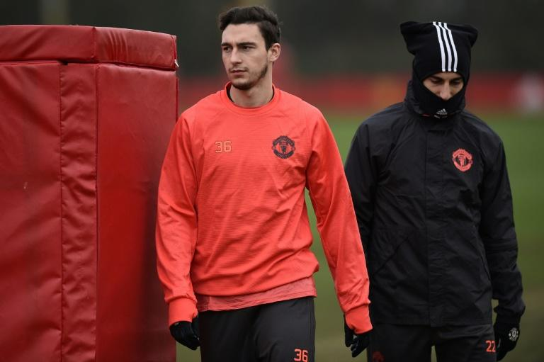 Manchester United's Matteo Darmian (L) and Henrikh Mkhitaryan attend a training session at their Carrington base in Manchester, on February 15, 2017