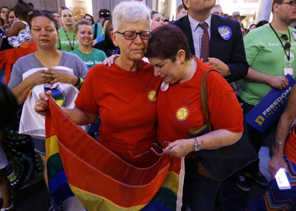 Betty Lynch, left, Carmel, Ind., and Annette Gross of Indianapolis, hug during a press conference in the Indiana Statehouse Rotunda in Indianapolis, Friday, June 26, 2015, after the Supreme Court declared that same-sex couples have a right to marry anywhere in the U.S. (AP Photo/Michael Conroy)